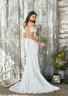 269c087aacf Elena - Mystical romance is created in this allover delicate lace fit and  flare gown featuring