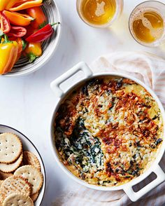 Ham-and-Spinach Dip | Martha Stewart Living - Whether you serve this Spanish-inspired creamy dip with crackers or fresh peppers, you can't go wrong. Just don't forget the beer!