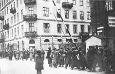 Warsaw, Poland, A group of Jews entering the ghetto gate at the end of the workday.