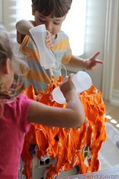 """Create a vibrantly colored """"burning building"""" with this easy sensory play idea! Great for community helpers and firefighter themes, fine motor, dramatic play."""