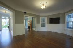 MATERIALS/ FLOOR: Hardwood floors/ WALLS: Wood panels on the lower half of the walls; upper half of the wall is smooth wall/ LIGHTS: Pendent light in the middle on the room provides all the needed light/ CEILING: Smooth ceiling; ceiling has antique  vines with flower decals that go 360 degrees around the ceiling/ TRIM: Base board trim, trim around windows and doors, as well as crown molding/ ROOM FEATURES: Speakers are hung  just under the ceiling around the room, to create a home theater…