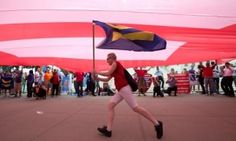 A supporter of gay marriage runs beneath a so-called equality flag outside the supreme court, where the justices handed down their decision on the matter in Washington DC. My Philosophy, Supreme Court, Constitution, Human Rights, Washington Dc, Equality, Lgbt, Marriage, Twitter