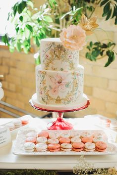 romantic wedding cake - photo by Mango Studios http://ruffledblog.com/garden-inspired-bridal-shower #weddingcake #cakes