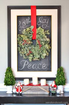 Holiday Eucalyptus Wreath on a chalkboard... so pretty! By Sand and Sisal