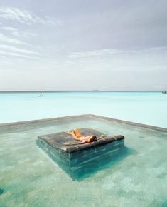 Why yes, I would like a stone bed in a pool in the middle of the ocean. Someone ship me to Bali! Places Around The World, Oh The Places You'll Go, Places To Travel, Places To Visit, Around The Worlds, Dream Vacations, Vacation Spots, Vacation Travel, Vacation Places