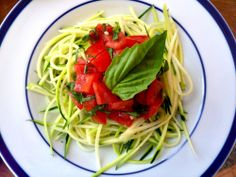 Zucchini Pasta al Pomodoro: 1 medium zucchini, julienned into long strands  1 roma tomato, seeded and diced  1 clove garlic, minced  3 large leaves of basil, chiffonaded  1 Tbsp. olive oil  1/8 tsp. sea salt  1/8 tsp. ground black pepper