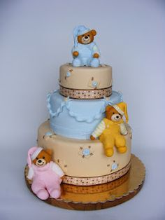 baby shower cake - pink and blue, with little teddy bears dressed in pajamas