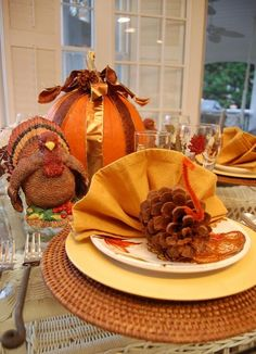 Love the pine cone turkey napkins...A Thanksgiving Tablescape for the Kid's Table