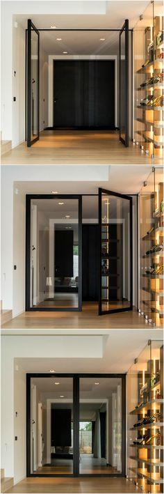 "Double pivoting door with offset axis pivot hinges. The black ""Steel Look"" frame is Anyway's most popular pivoting door and is purely custom-made. #pivotdoor #pivotdoors"