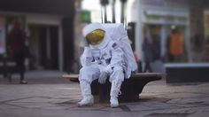 Sad astronaut lost in a park on earth. - Stock Video Footage ...
