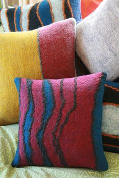 Handfelted merino wool pillows.