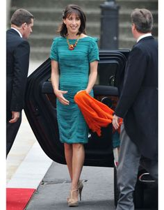 Samantha Cameron, wife of Prime Minister David Cameron, arrives in a turquoise Burberry shibori-dyed sheath.