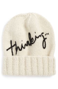 Letting everyone know when the wheels are turning with this hand-knit alpaca beanie featuring a playful typography embellishment.