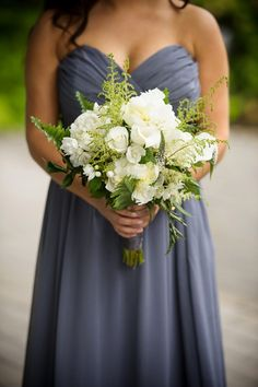 White wedding bouquet against a grey bridesmaids dress