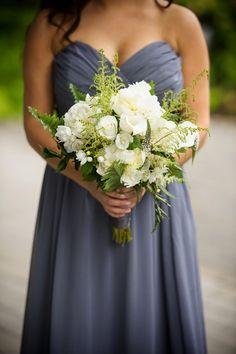 White wedding bouquet against a grey bridesmaids dress