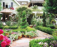 Don't be afraid of color in your front yard. A riot of shades gives this landscape a romantic cottage garden feel: http://www.bhg.com/gardening/landscaping-projects/landscape-basics/front-yard-flower-power/?socsrc=bhgpin031914beplayful&page=7