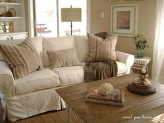A Pottery Barn slip~covered couch in white twill.
