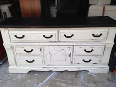 This was a commissioned piece. The client wanted the milky white distressed look.