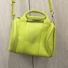 """Alexander Wang Rocco in Acid Green Great Condition ❤️ Dust Bag Included ❤️  Approx. 9""""H x 10.2""""W x 7.9""""D ❤️ Only flaw is the back is a bit stained as seen in the fourth picture ❤️ No trades or no paypal Alexander Wang Bags"""