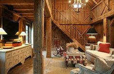 A barn conversion with rough- hewn wood and amazingly high ceilings.