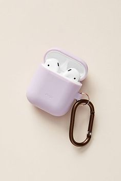 Elago AirPods Hanging Case by elago in Purple, Stationery at Anthropologie Accessoires Iphone, Phone Organization, Air Pods, Airpod Case, Airpod Pro, Tech Accessories, Apple Watch, Headphones, Iphone Cases