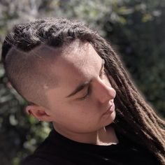 This half head of dreads, half shaved look is another unique dreadlock style. A benefit of half dreads is they become easier to tie up, which is great if you have loads of locs with plenty of length. Half Dreads, Partial Dreads, Shaved Sides, Half Shaved, Dreadlock Hairstyles, Loose Hairstyles, Dreadlock Styles, Hair Pulling, New Growth