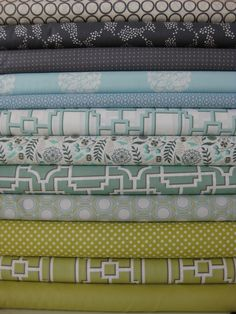 12 fat quarters green, blue, grey.  $31.50 fabric for kitchen stool covers