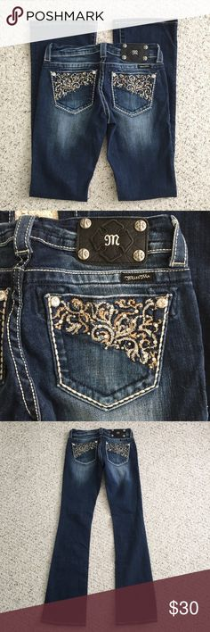 """Miss Me Boot Cut Blue Jeans Size 26 Women's Miss Me Blue Jeans  Boot Cut  Super cute embellishing on the back pockets  Size 26  Inseam is 33""""  Total length is 39.5""""  Excellent condition. Natural distressing in the wash. No stains or flaws.  SMOKE FREE HOME Miss Me Jeans Boot Cut"""