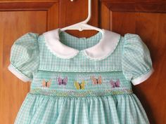 Seafoam gingham hand smocked dress with butterflies smocking Size 12Mo/1T. $45.00, via Etsy.