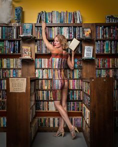 Naked lady perfectly blends into bookshelf | Dangerous Minds