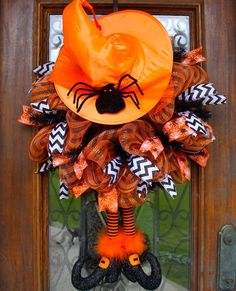 Super cute Halloween witch hat and legs wreath www.facebook.com/southernsass