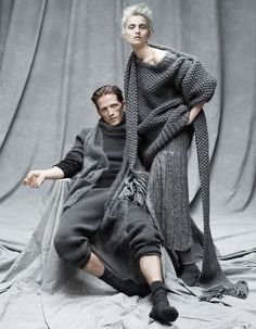 He wears Michael Kors cashmere jumper, £695, matching long johns, £435, and mohair scarf, £345. Pantherella wool socks, £14. She wears Michael Kors alpaca hand-knitted jumper, £580, sequin-silk culotte, £5,600, and alpaca hand‑knitted scarf, £360. Pantherella wool socks, £18