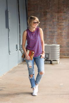 Seersucker and Saddles. Red and blue top+distressed jeans+white sneakers+colourful clutch. Spring/Summer outfit 2016