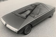 Having no new models to reveal at the 1980 Paris Salon, Citroën stylist Trevor Fiore was given the go ahead to build a model (not a driveable car) for display. The result was the trapezoidal Karin, clearly inspired by Michel Harmand's design for a GS Coupé. A three seater with the driver being...