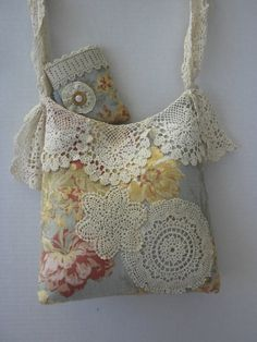 Vintage Blue and Cream Shabby Chic Handbag Purse by touchograce. The doily like lace flower embellishments can be replicated by doing a freehand embroidery stitched pattern on a piece of dissolvable fabric.