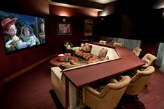 Amazing Media room ideas.. love the idea of the table wrapping around the back and comfy chairs for having a meal or snack