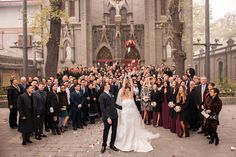 Guests gather to grab the bouquet. What you can't see in this picture is the crowd of bemused local Beijingers behind the camera wondering what is going on in the church courtyard!