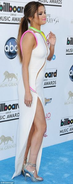 Selena Gomez flashed legs in silver high heels in a slit up the side of her gown at the 2013 Billboard Awards