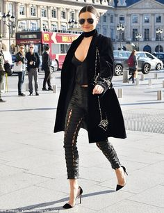 Miranda Kerr stuns in busty plunging top and leather trousers