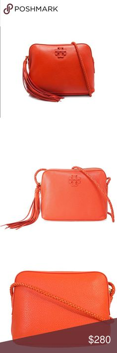 Tory Burch Taylor Pebbled Leather Camera Bag This gorgeous vibrant orange camera bag crossbody is just the perfect bag for all your essentials. Small enough for evenings out with just a few products while big enough to store wallets and bigger items you need during the day! The pebbled leather is soft and luscious and the color adds a pop of color to any outfit that needs it! Tory Burch is known for her bags, and this one is in perfect condition! Why not get this very versatile crossbody and…