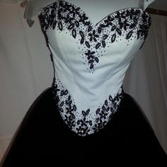 Gorgeous black and white formal.not included bund. Black/white formal.  Worn once.  Has been dry cleaned ready for you. Like new.  Smoke free home. Can't bundle. Dresses