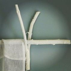 A great DIY on how to use twigs & white paint to create curtain rods & twig decor.I think I may like natural colored twigs better for my decor. How To Make Curtains, Diy Curtains, Sewing Curtains, Bedroom Curtains, Kitchen Curtains, Branch Curtain Rods, Metal Curtain, Decorating Your Home, Diy Home Decor