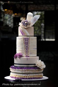 You can Find the perfect Wedding Cake Vendor on www.brides-book.com I love the feathers at the top!!