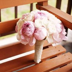 Pink peonies, ranunculuses and roses bouquet.