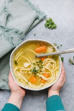 This Homemade chicken noodle soup recipe is the EASIEST freezer meal! Cook the soup, dump into a freezer bag, and just thaw out when ready to eat. Pair with a fresh salad or warm bread for a dinner the whole family will enjoy. hvia happymoneysaver #freezermeal #easydinner #chickennoodlesoup #chickensoup #noodles #herbs #sickfood #makeahead #soup