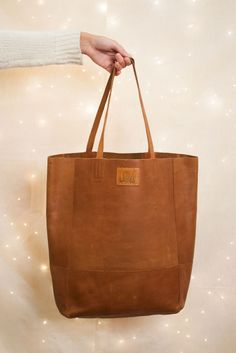 Leather Bucket Bag from Sseko Designs    The perfect tote for everyday, and the perfect gift for any lady in your life this holiday! Handcrafted in East Africa, each bag helps to send a girl to college. #GiftsThatGive