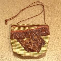 "Carlos Falchi vintage raffia and leather purse Vintage bag in perfect condition. Brown and tan raffia and leather. Single brown leather strap falls 21"" from shoulder. Zipper closure. Carlos Falchi Bags Shoulder Bags"