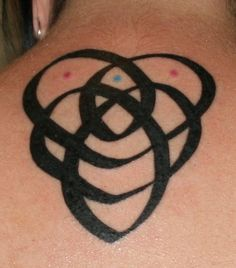 Celtic motherhood knot. Add a birthstone color dot for each child and grandchild. (wrist)