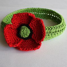What and adorable and silly headband for a baby!   Ravelry: Headband Poppy pattern by Julia Noskova