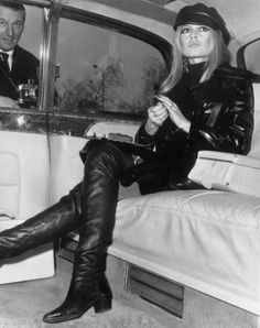 Bardot arrives by limousine at London's Heathrow airport in 1968